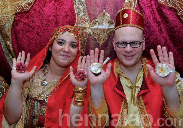 The writer's son and daughter-in-law hold up their hennaed hands for a photo-op.. (photo credit:YEHUDIT HELFON)